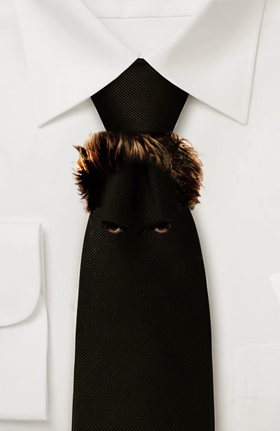 Photo of a black necktie with Robert Pattinson's hair and eyes on it.