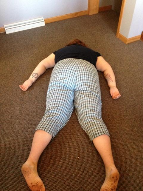 Me lying face down on the floor, taken from a really unflattering angle