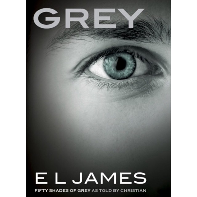 Cover of E.L. James's Grey, picturing a close up of a face and one open eye.
