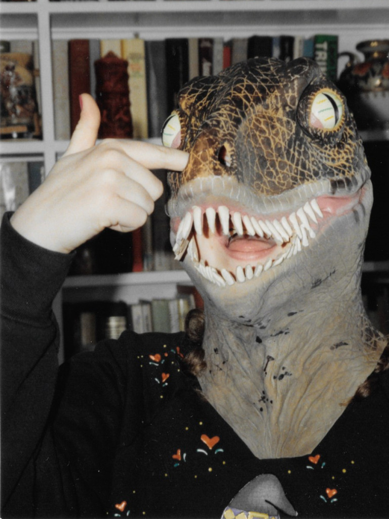 Teen me wearing a rubber velociraptor mask and picking the nostril hole.