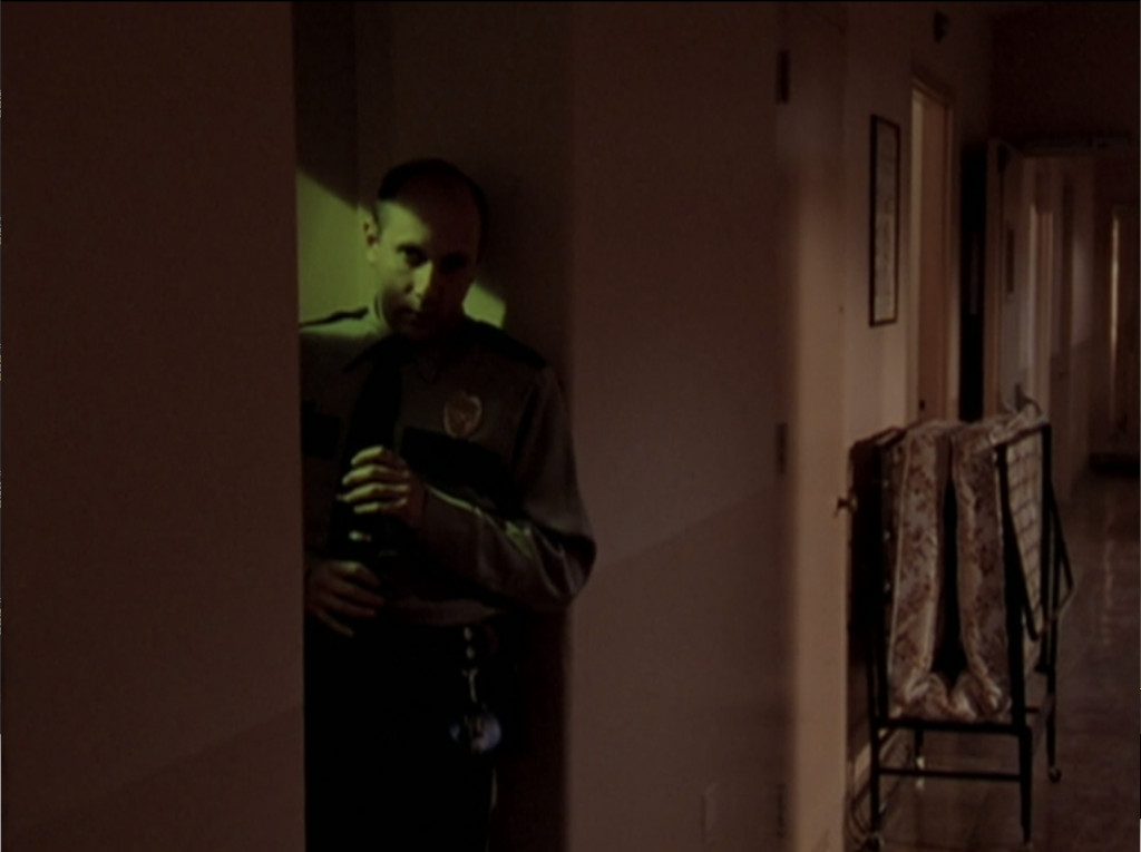 Security guard lurking creepily in the hallway like some kind of weird pervert.