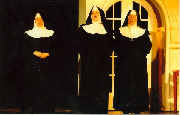 Teen me in a nun's habit, singing.