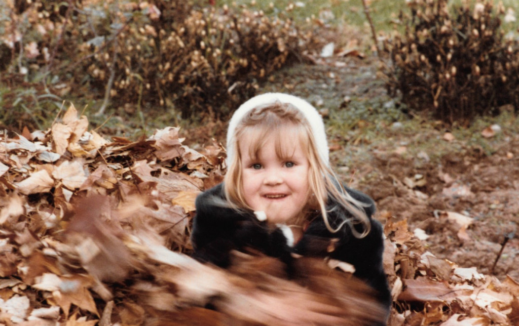 Four year old me playing in a leaf pile
