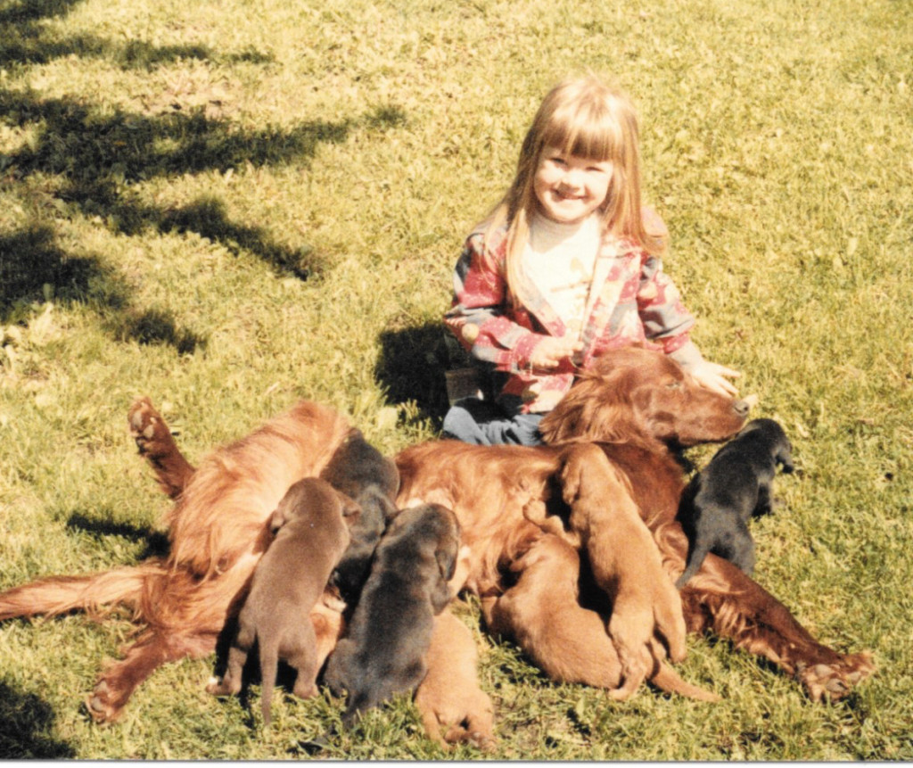 Me as a child with a nursing dog and way too many puppies