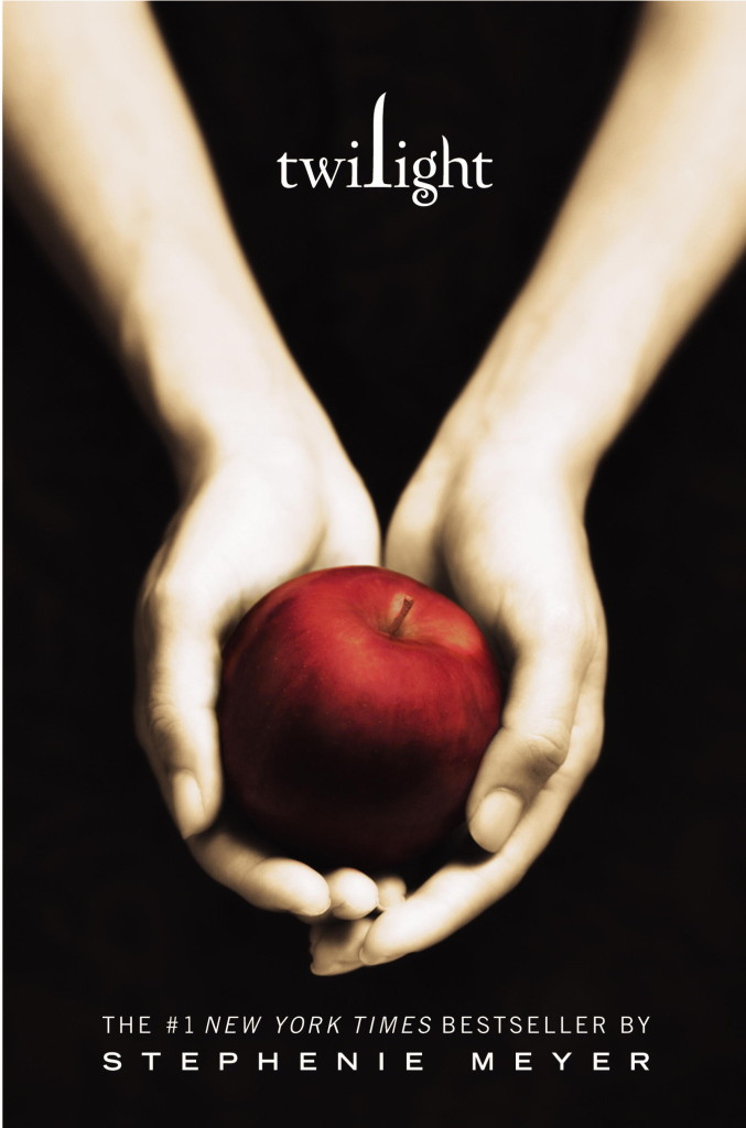 The cover of Twilight, featuring two hands holding an apple.