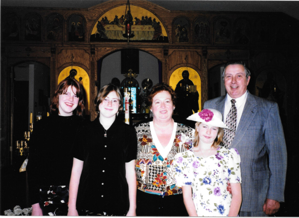 Me, my cousins, and my paternal grandparents, standing in front of the iconostas at their Orthodox church.