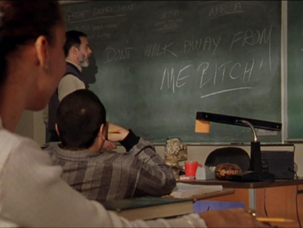 "The blackboard reads ""Don't walk away from bitch!"""