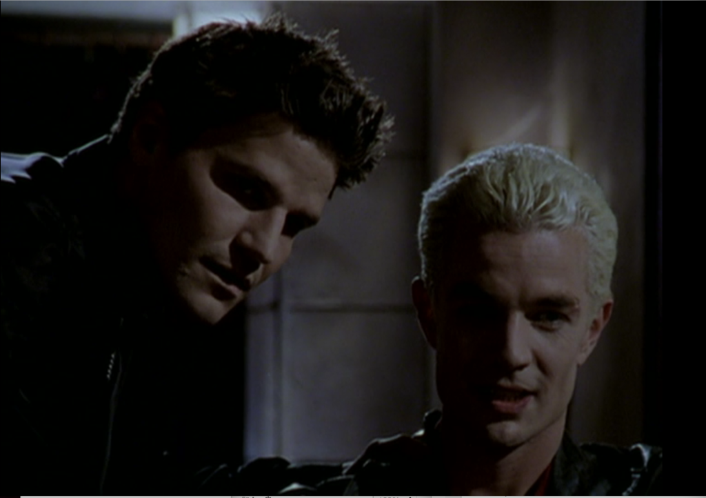 Angel annoyed and jealous, Spike amused.