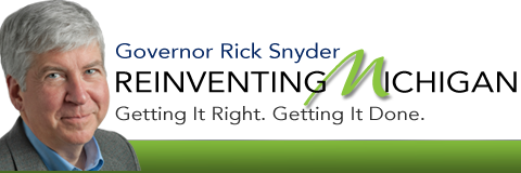 """Picture of MI Governor Rick Snyder in front of a banner that reads """"Reinventing Michigan: Getting it right. Getting it done."""""""