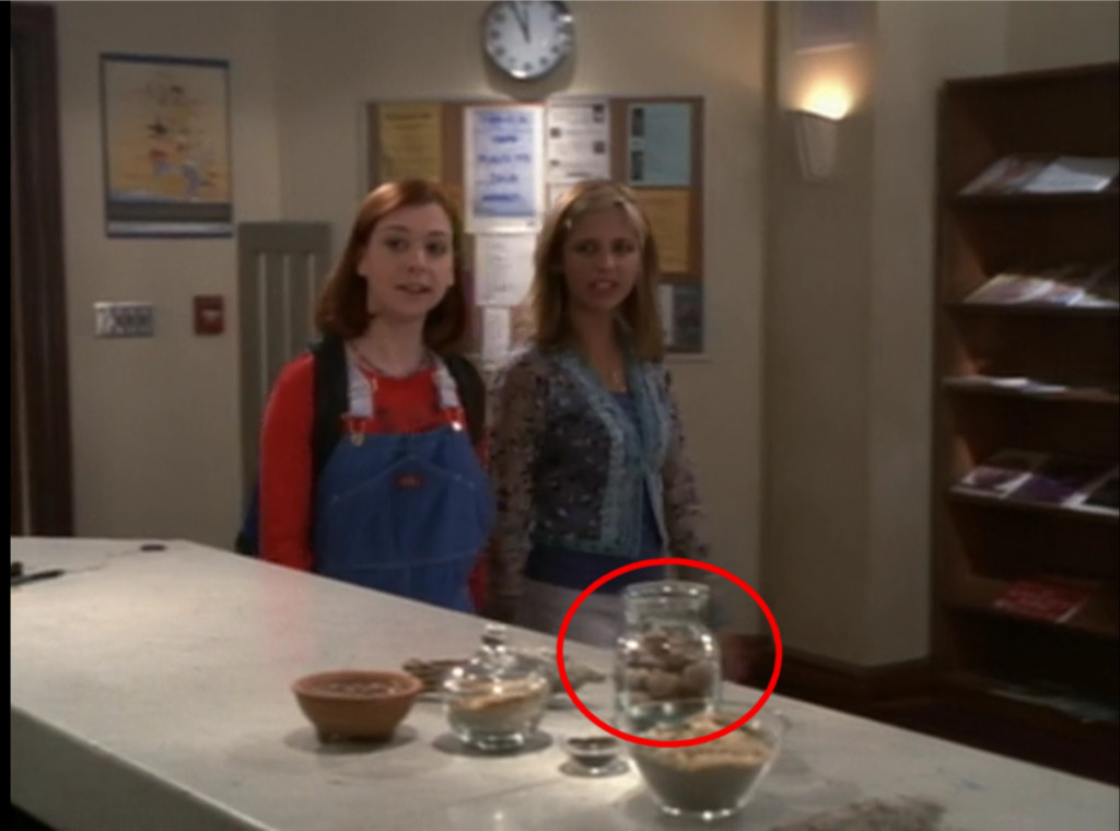 Buffy and Willow are walking into the library, and on the counter there are various little bowls and jars of herbs. One of them looks like a glass stash jar full of nugs.