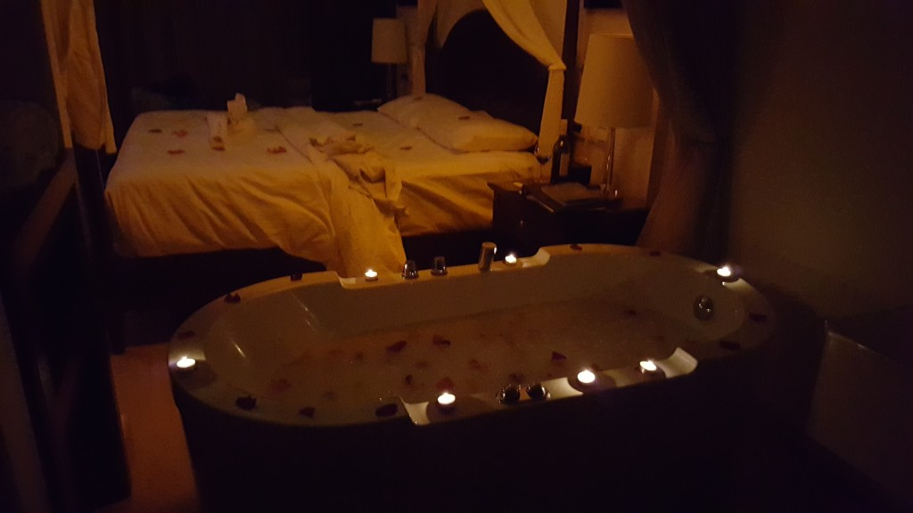 The jacuzzi tub, surrounded by candles, with a bubble bath inside and rose petals on top. It's directly beside a huge four poster bed with rose petals sprinkled all over the duvet.