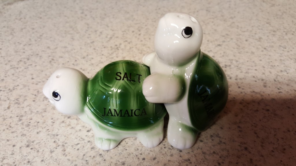 Ceramic salt and pepper shakers shaped like turtles. They fit together so as to suggest that they are humping.