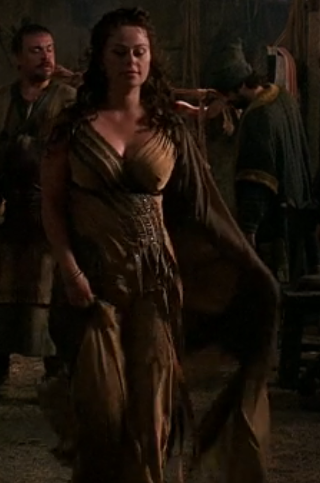 Atia's dress is really slinky gold silk, with strips of beading across her boobs and a nice silk cape thing that has great movement.