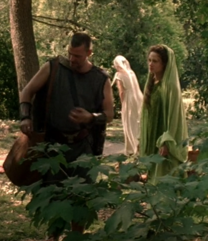 A bad screen cap of Pullo and Eirene standing in the little glad where they have their murder day picnic. Eirene's veil is very light green, her dress is darker green.