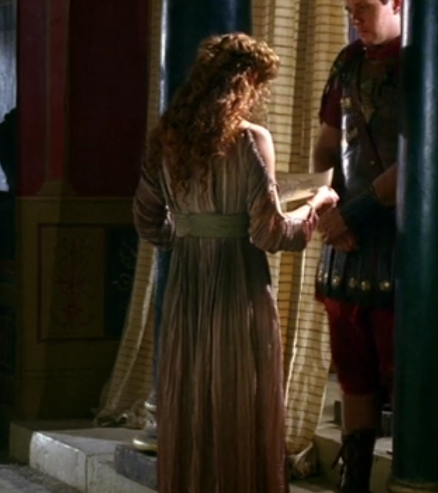 Octavia's dress, shown from the back, has like, open sleeves, and it's like, dip dyed or something, so the pink and the green and the yellow kind of blend all together in a gradient.