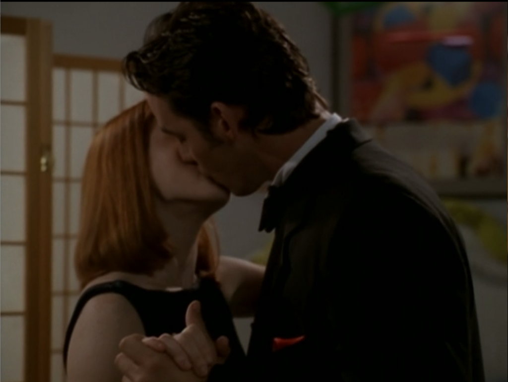 Willow and Xander are kissing. Not even like a little peck. Full on kiss.