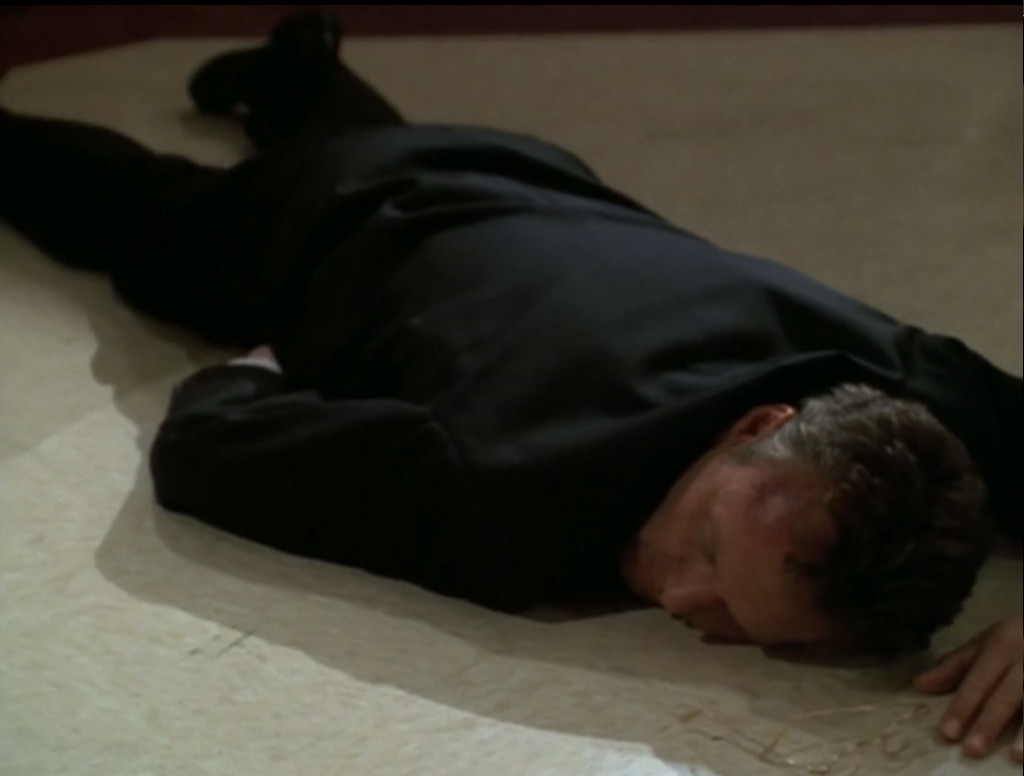 Giles, lying unconscious on the floor.
