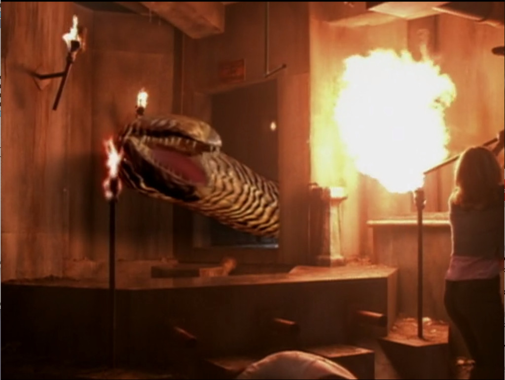 Lurconis is a big, eye-less serpent thing with black and white zig zag stripes and lots of pointy teeth. Buffy is about to immolate it with a fireball from the gas pipe.
