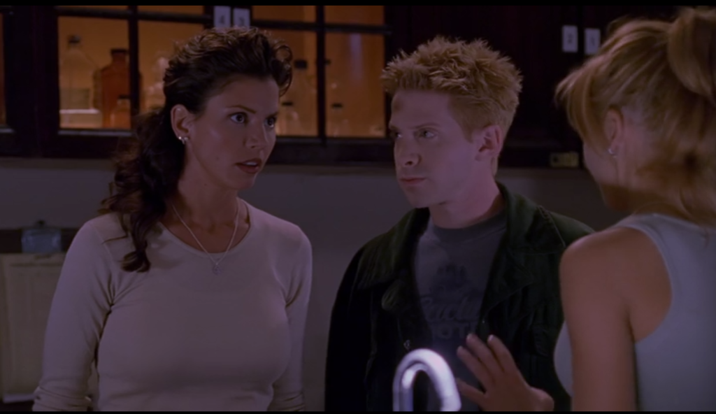 Buffy and Oz stand beside Cordelia in the chemistry lab. Cordelia's hair is a high-volume cascade of the most perfectly non-perfect curls in the universe. She has more hair than a princess.