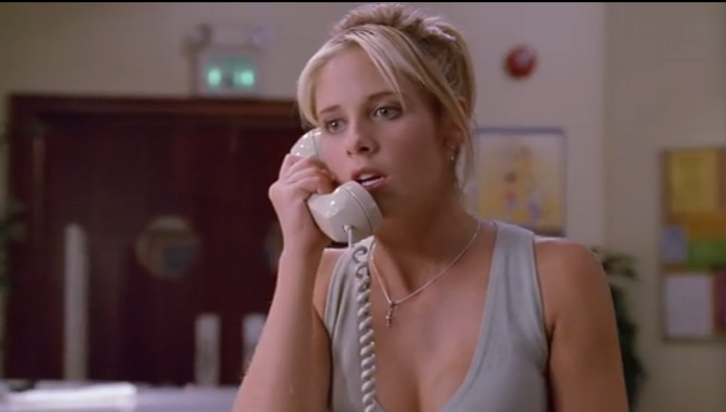 Buffy is on the phone, and she looks horrified.