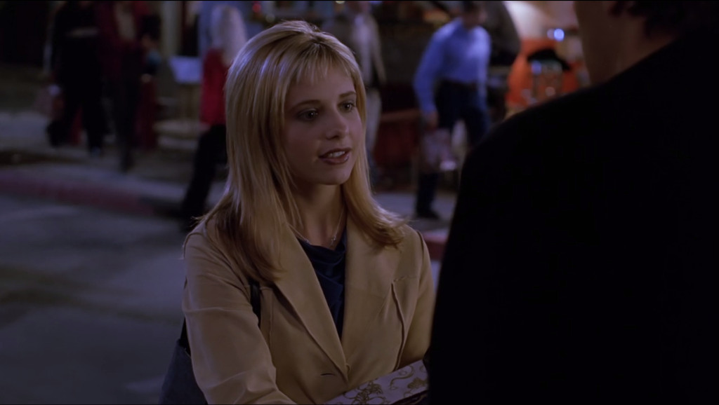 Buffy's hair looks like a bad wig. There's no other way to describe it. Her bangs are way too short for her face.