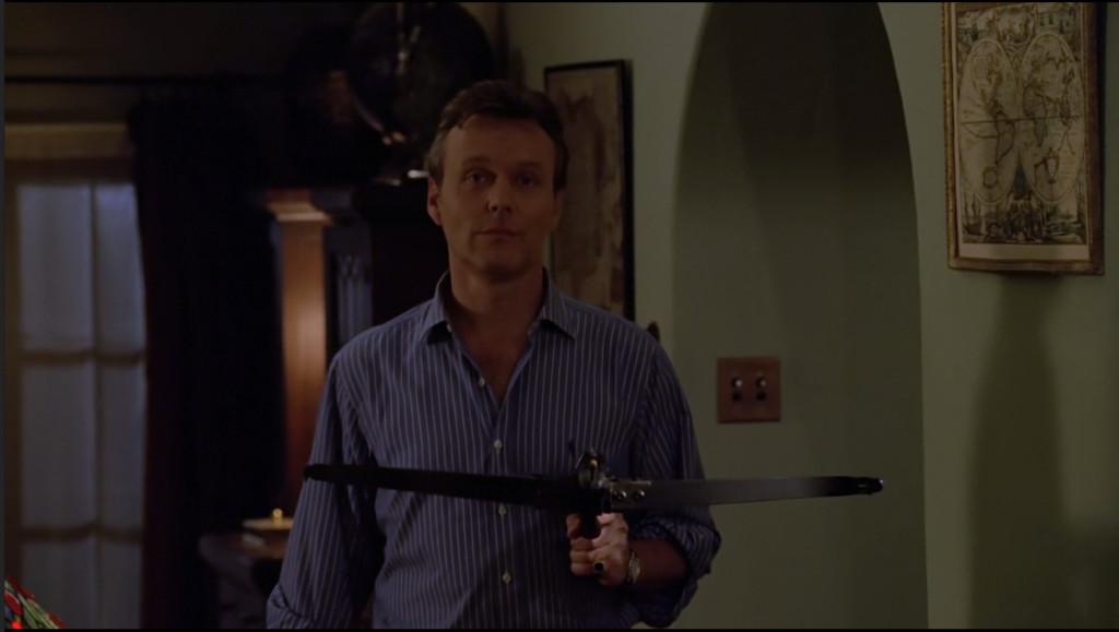 Giles, holding a crossbow with an expression that clearly displays that he's out of fucks.