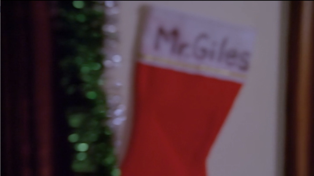 "A Christmas stocking that says ""Mr. Giles"" on it."