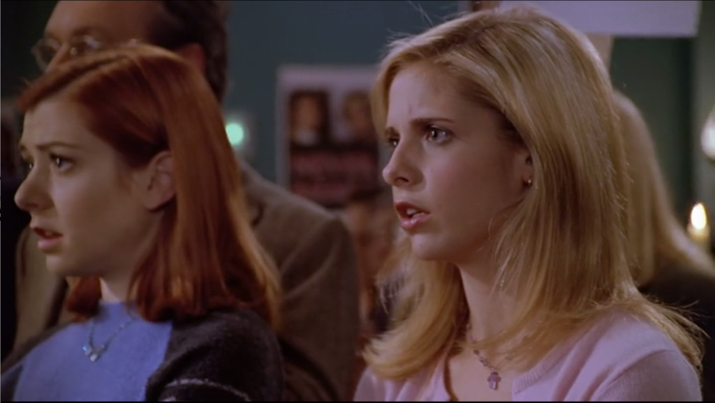 Buffy and Willow staring in disbelief at Joyce's words.