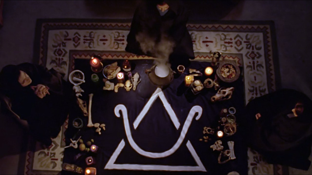 Amy, Willow, and some random other witch sitting around a large arcane symbol printed on black cloth. All around the edges are witchy things like various bones and candles and mushrooms and stuff in a mortar and pestle.