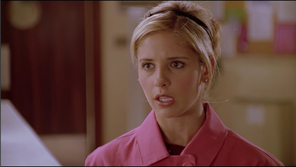 Buffy's eyes are wide, her mouth open, caught mid-speech.