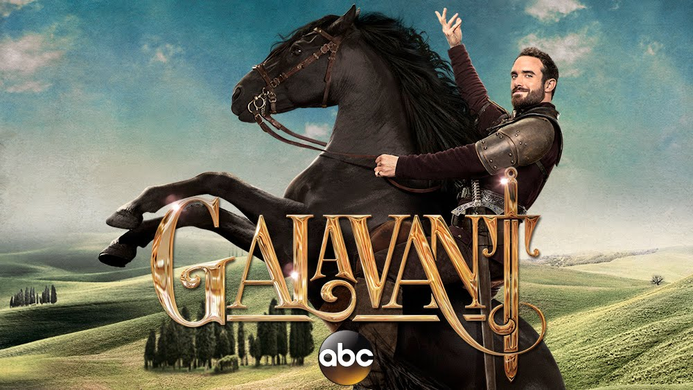 Galavant, a handsome knight, poised on the back of a rearing black horse, his hand held up in a flourish. The background is an idyllic fantasy countryside, and the title of the show is printed across the foreground.