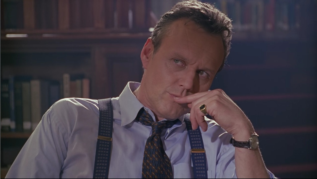 Giles, touching his mouth while he's thinking.