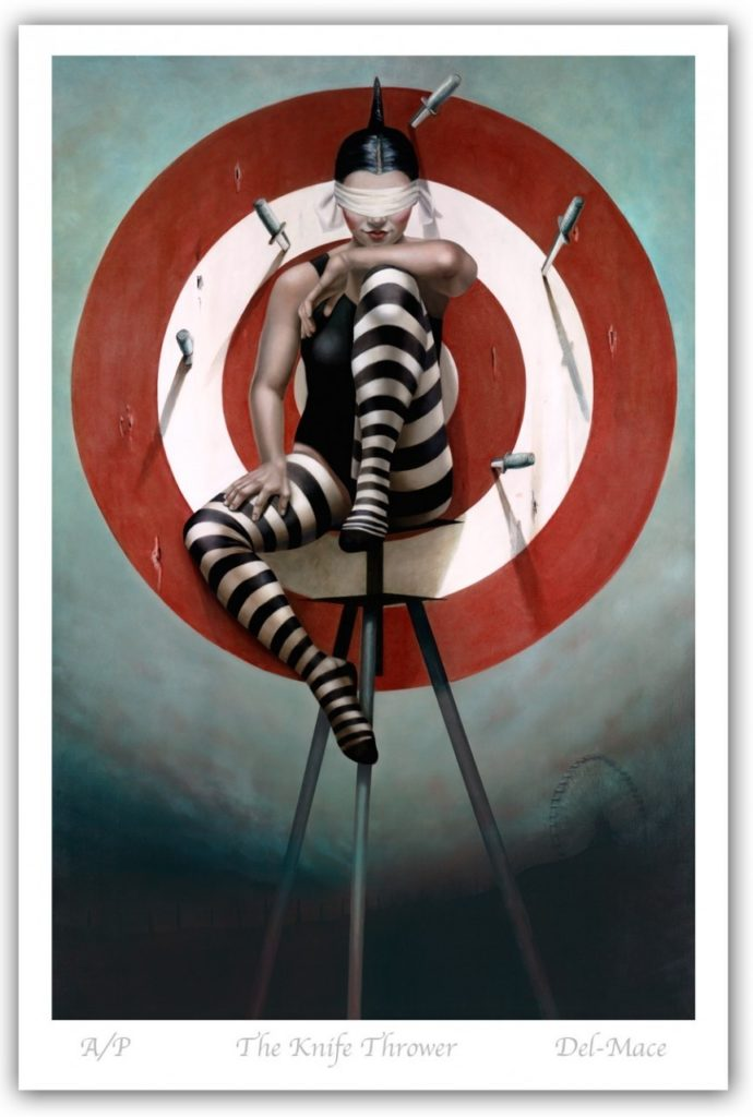 A blindfolded woman poses atop a precarious structure in front of a large bullseye, which is pierced with knives.