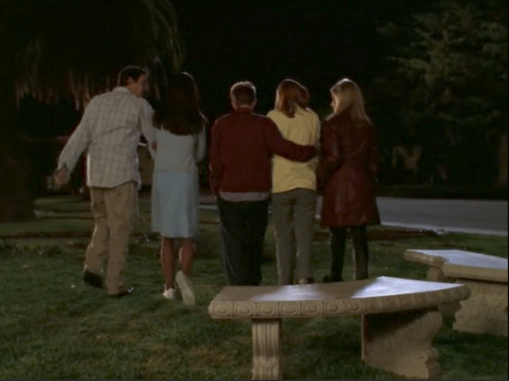 L-R, Xander, Cordelia, Oz, Willow, and Buffy all walk a tight little group into the night.