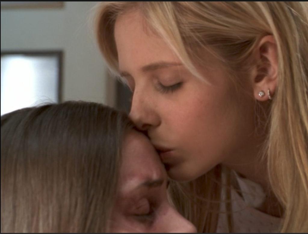 Buffy kissing Faith's forehead