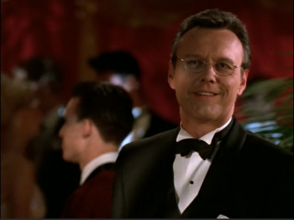 Giles is in a tux. And he's smiling. But most importantly, Giles is in a tux.