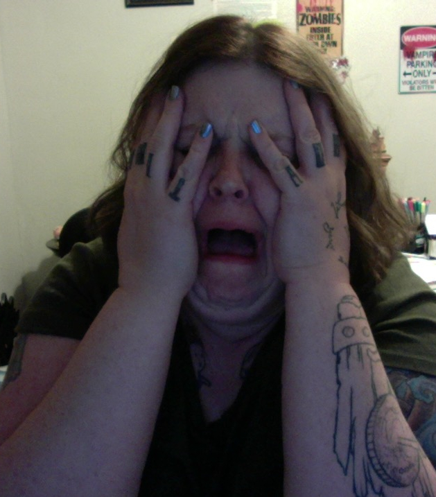 Me, with my hands over my face while I sob uncontrollably.
