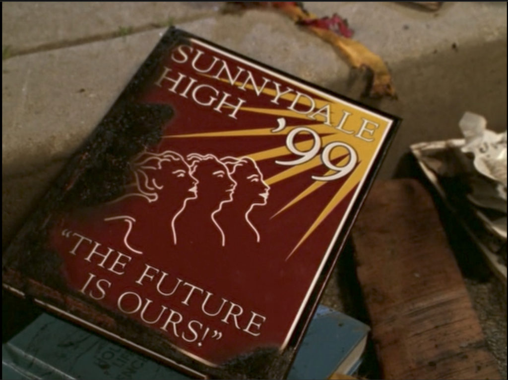 A 1999 Sunnydale High yearbook with a slightly charred cover.
