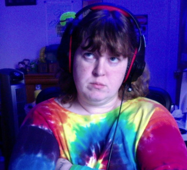 Me, wearing tie-dye and headphones, looking awesome, but also pissed off.