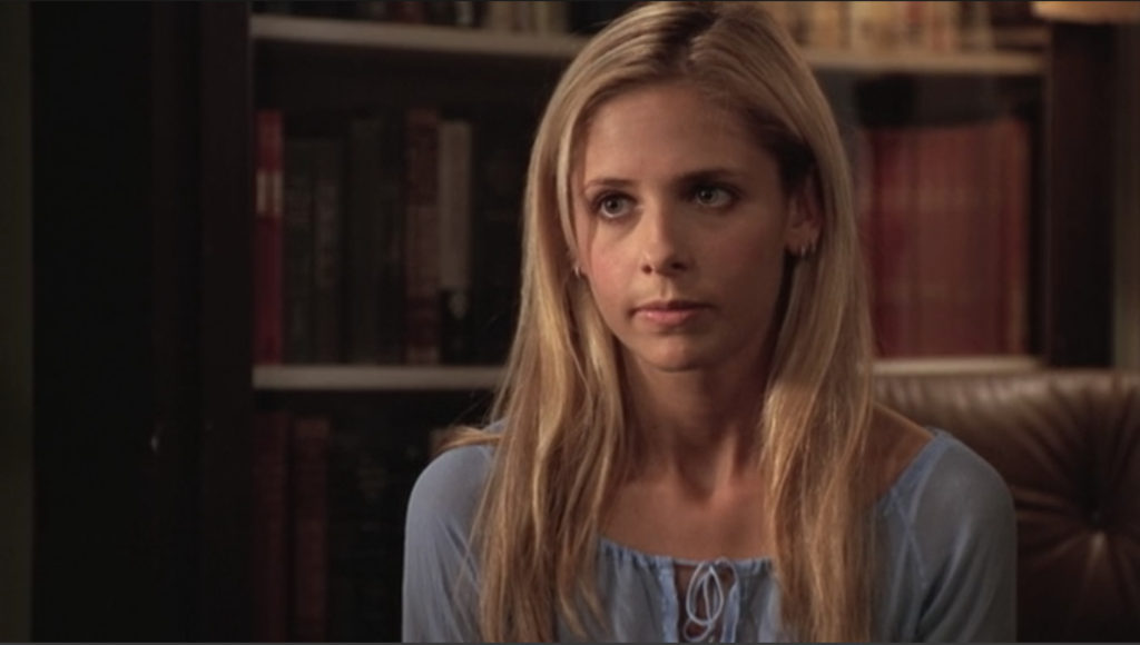 Buffy's got this face on like she's waiting for Giles to catch up.