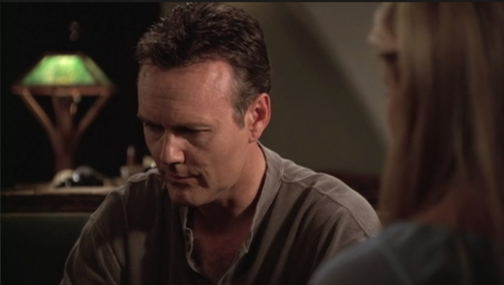 Giles looks super conflicted and sad and doesn't look Buffy in the eye.