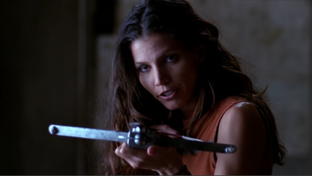 Cordelia is facing down Spike with a determined look and a crossbow.