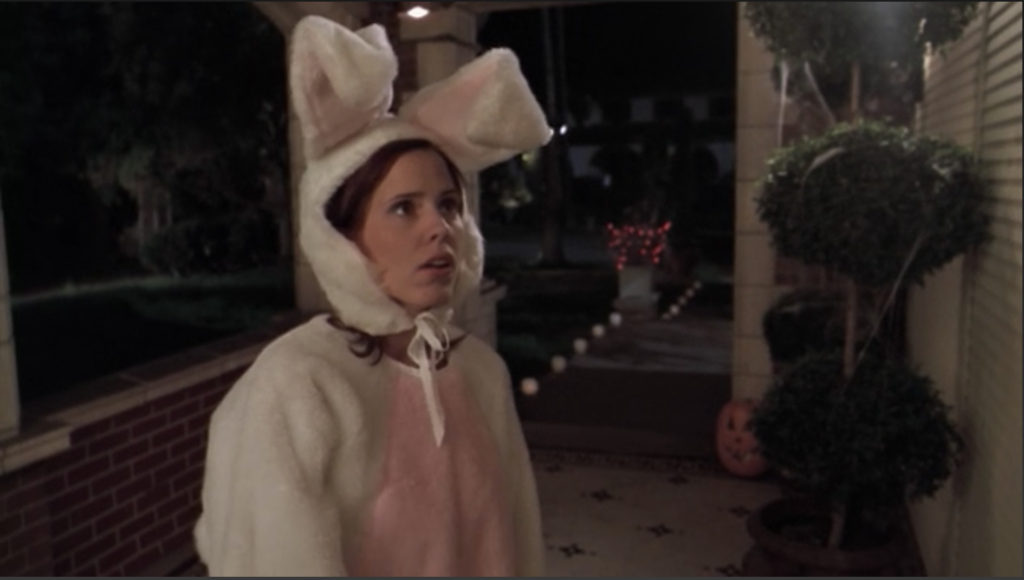 Anya is wearing an Easter bunny-style suit, but the ears/head is a hood that allows her face to be shown.