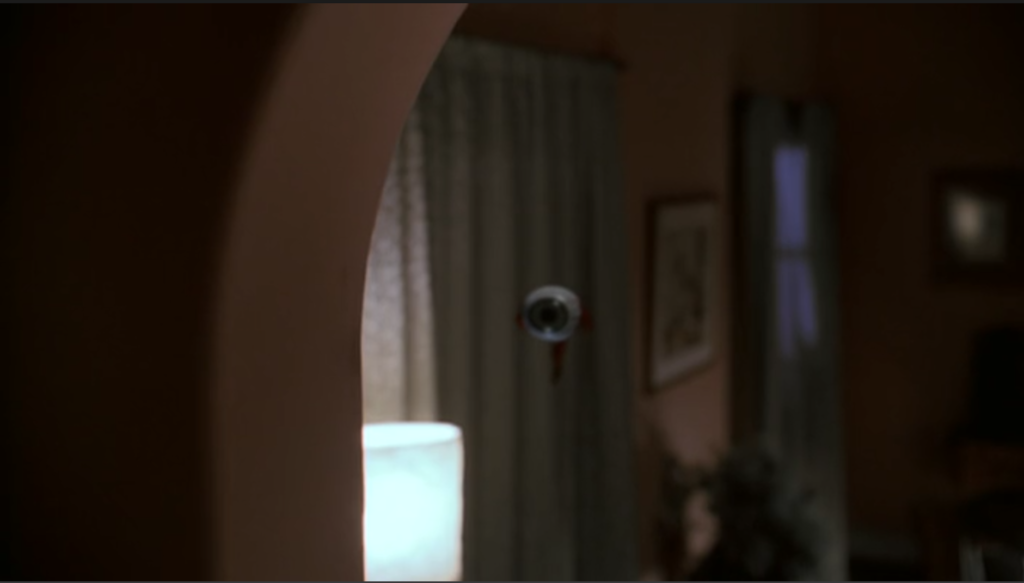Ronald's actual, physical eye is floating the air in Melissa's bedroom.