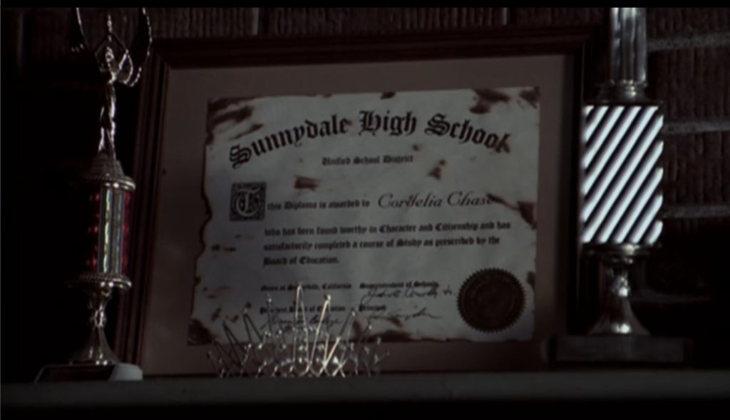 Inside its frame, Cordelia's diploma is all burned up.