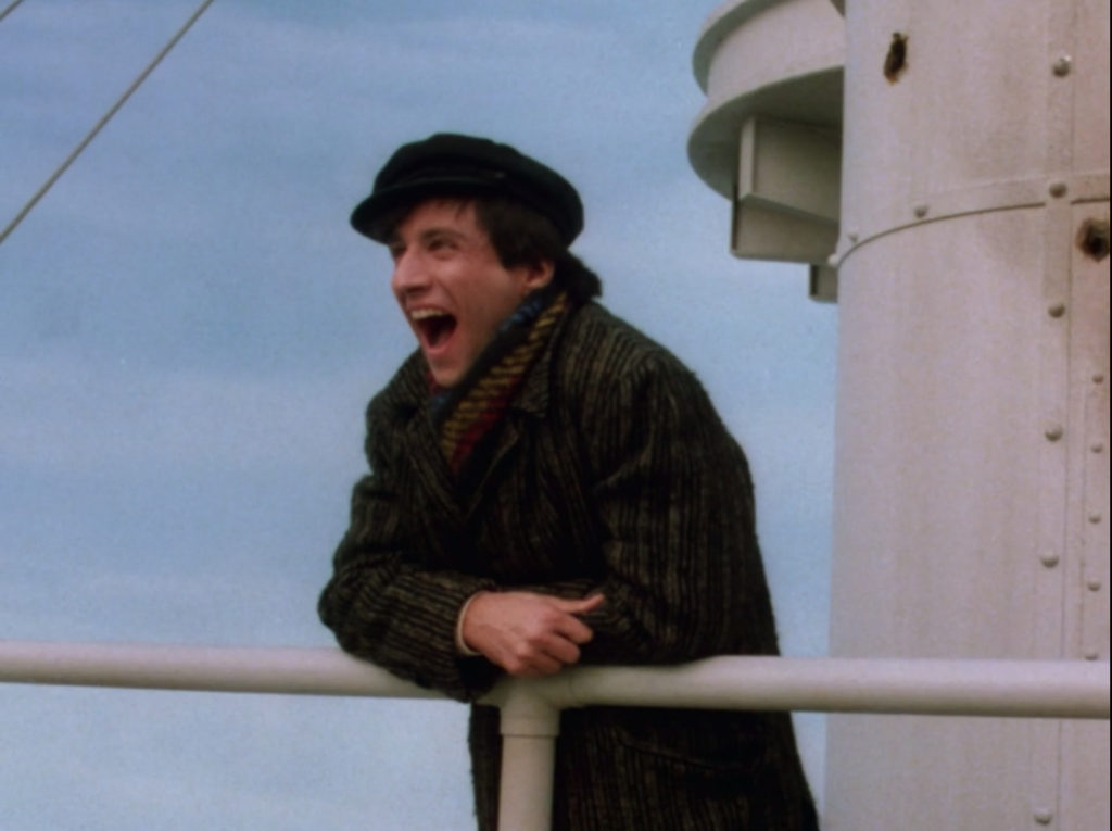 Balki, dressed in clothes that he probably inherited from my immigrant great-grandparents, standing at a ship railing, nothing but blue sky behind him.