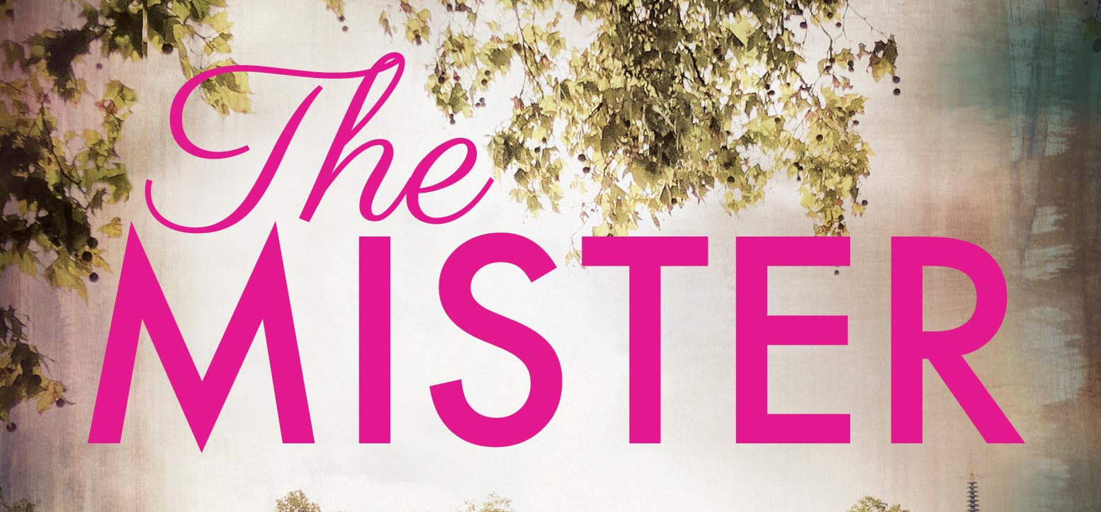 A slice of the cover of E.L. James's THE MISTER, with the title in pink with some leaves above it.