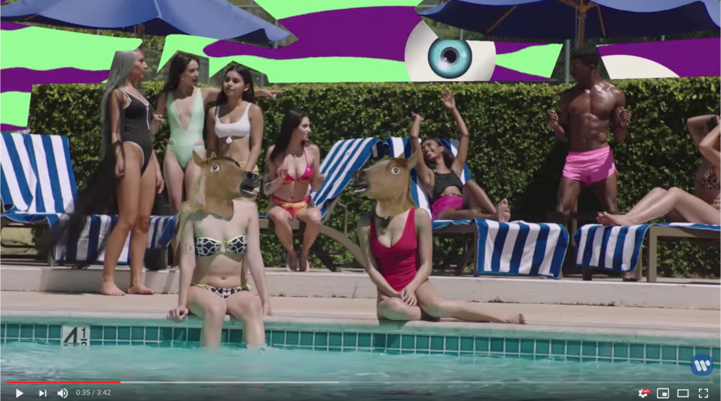 A shot of several sexy women in bikinis. Two of them have rubber horse masks green-screened over their faces.
