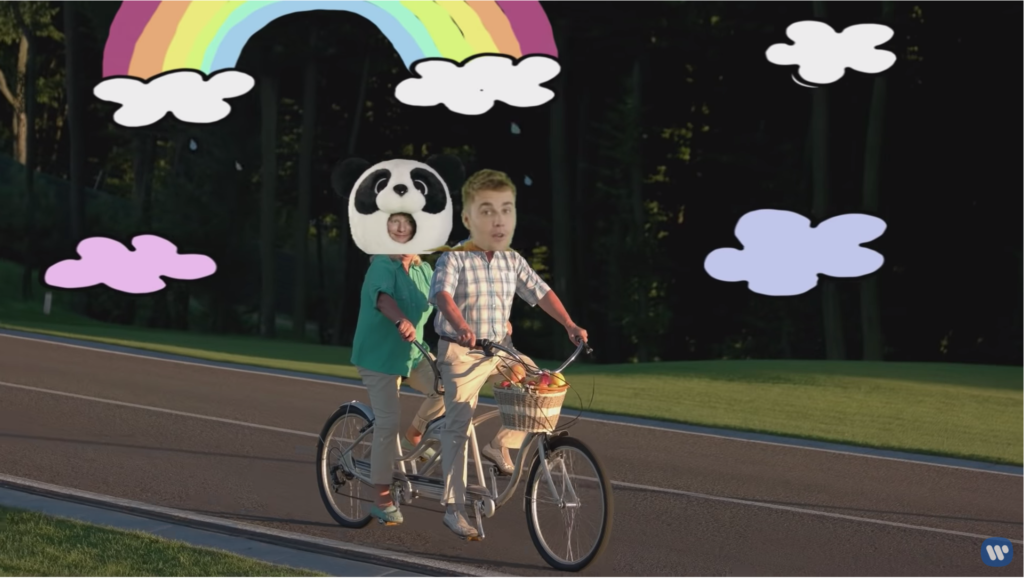 Justin and Sad Panda Ed's heads are superimposed over the heads of a senior citizen couple riding a tandem bicycle.