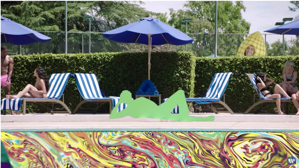 The same pool scene, but now the water is a mass of swirling colors, Ed is a green silhouette, and Justin Bieber is a corn-on-the-cob bouncing merrily around in the background.